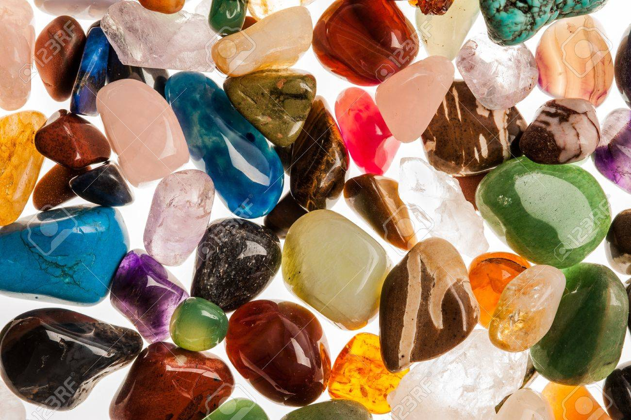 Assortment of polished semi-precious gem stones shot in the studio against white background - 19593283