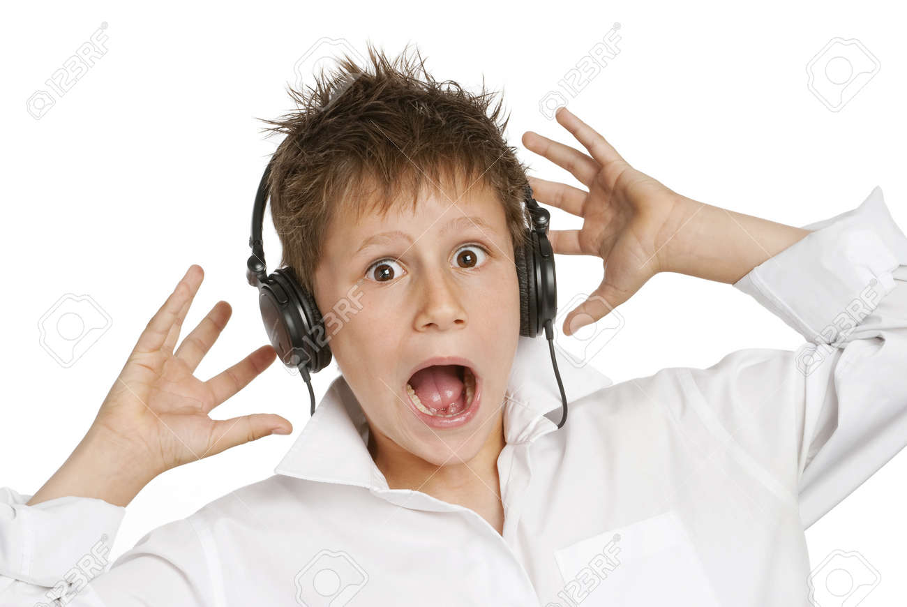 Boy with headphones, shocked and startled by loud noise - 19627926