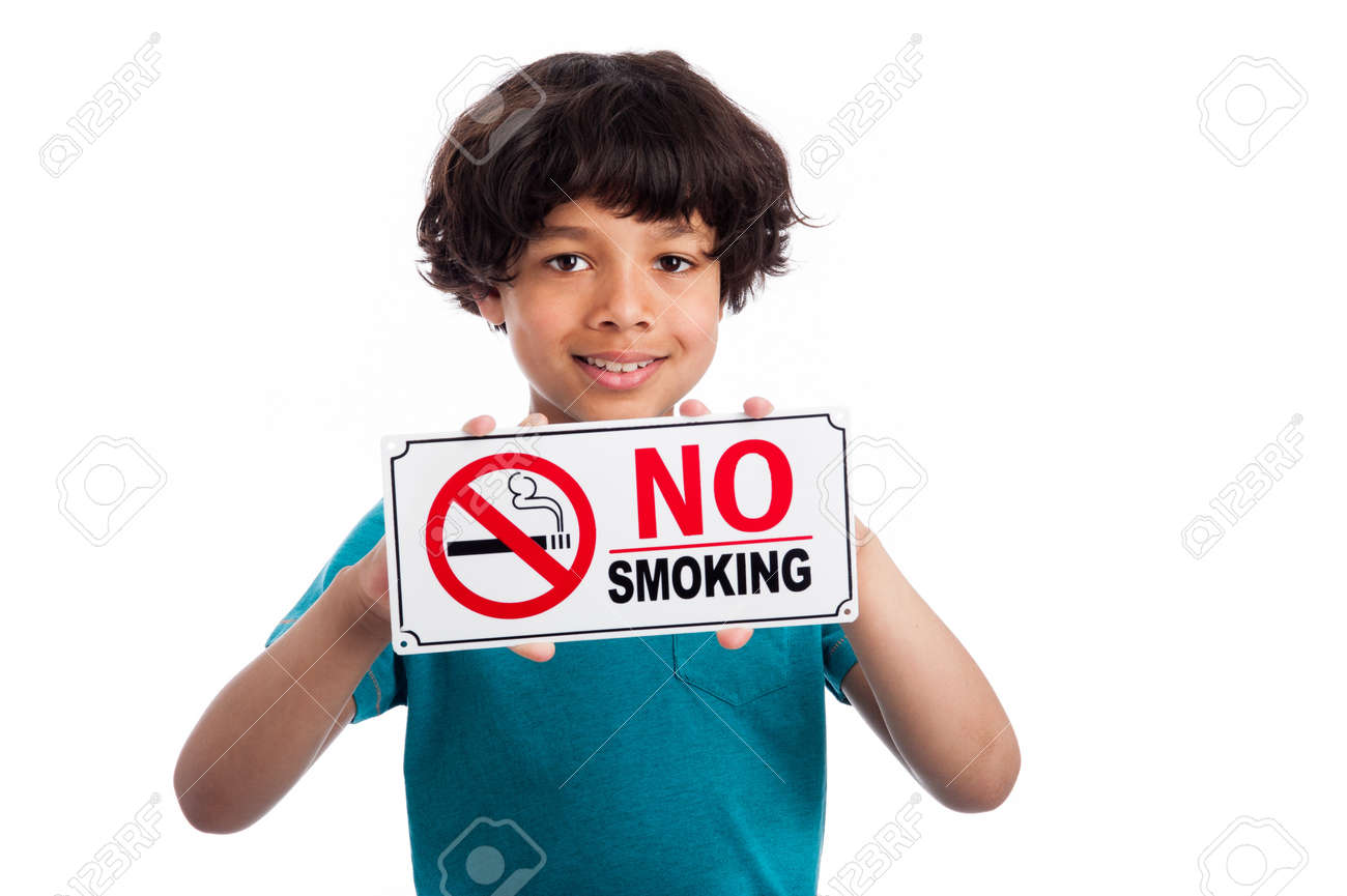 Cute mixed race kid holding no smoking sign. Isolated on white background. - 20824692