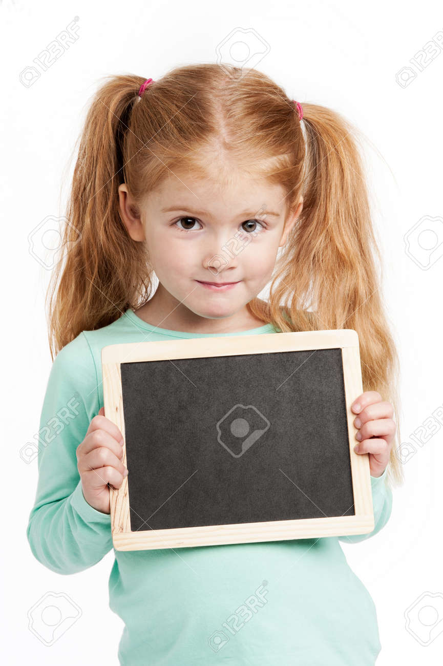 Cute three year old girl holding a small chalkboard. Isolated on white background. - 22351234