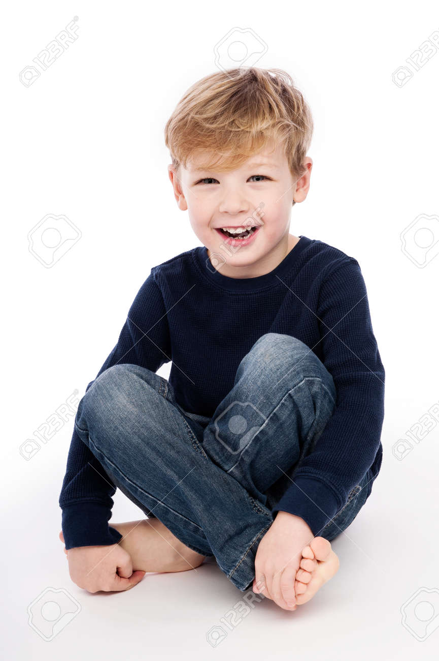 Happy boy shot in studio, isolated on white background. - 24933071