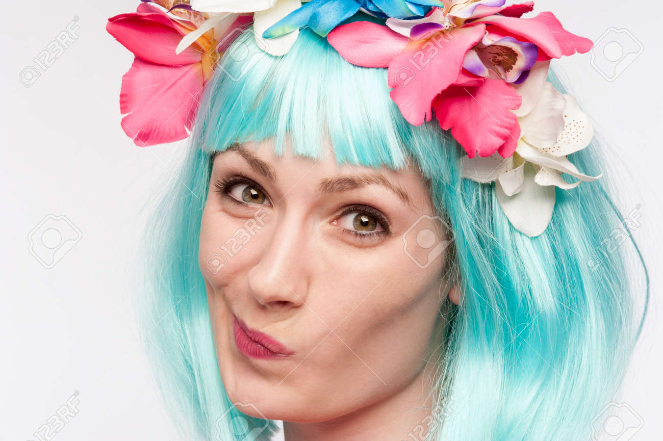 Girl With Flower Headband And Crazy Wig Shot In The Studio On