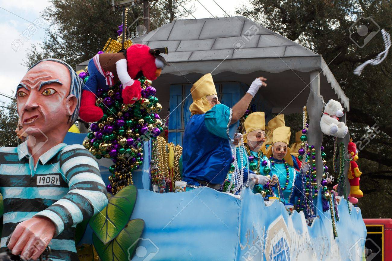 A masked rider throws beads from a float to revelers during a Mardi Gras parade in New Orleans Stock Photo - 9868297