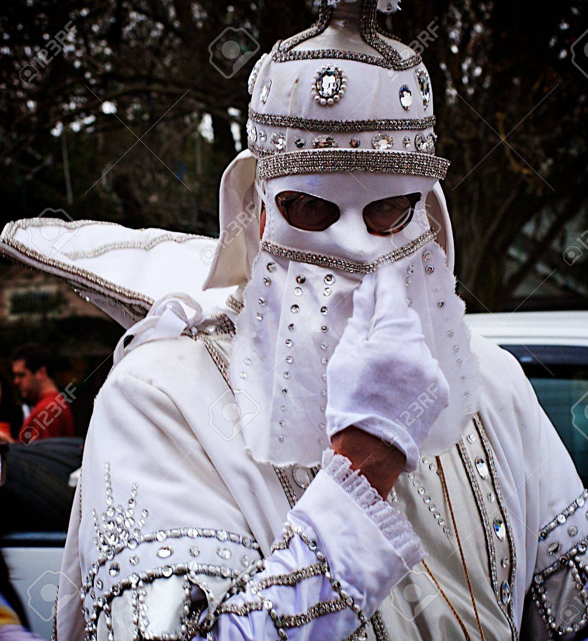 A white knight adjusts his mask while getting ready to ride in a mardi gras parade in new orleans Stock Photo - 9868022