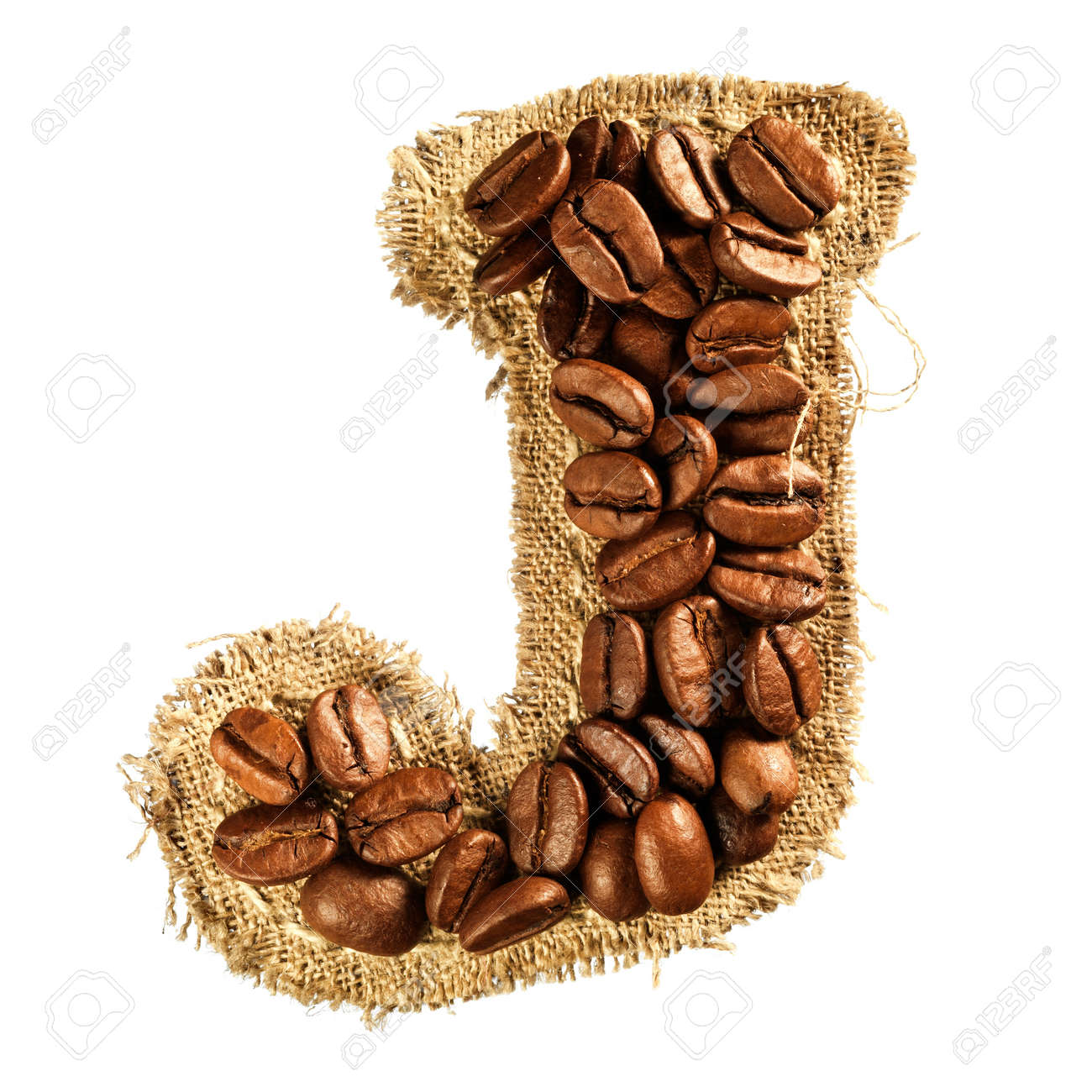 Alphabet from coffee beans on fabric texture isolated on white background Stock Photo - 17468129