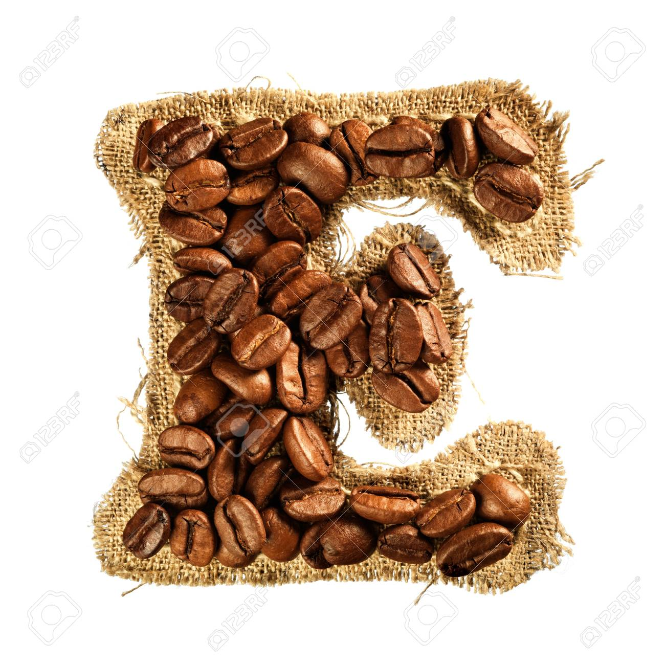 Alphabet from coffee beans on fabric texture isolated on white background Stock Photo - 17468165