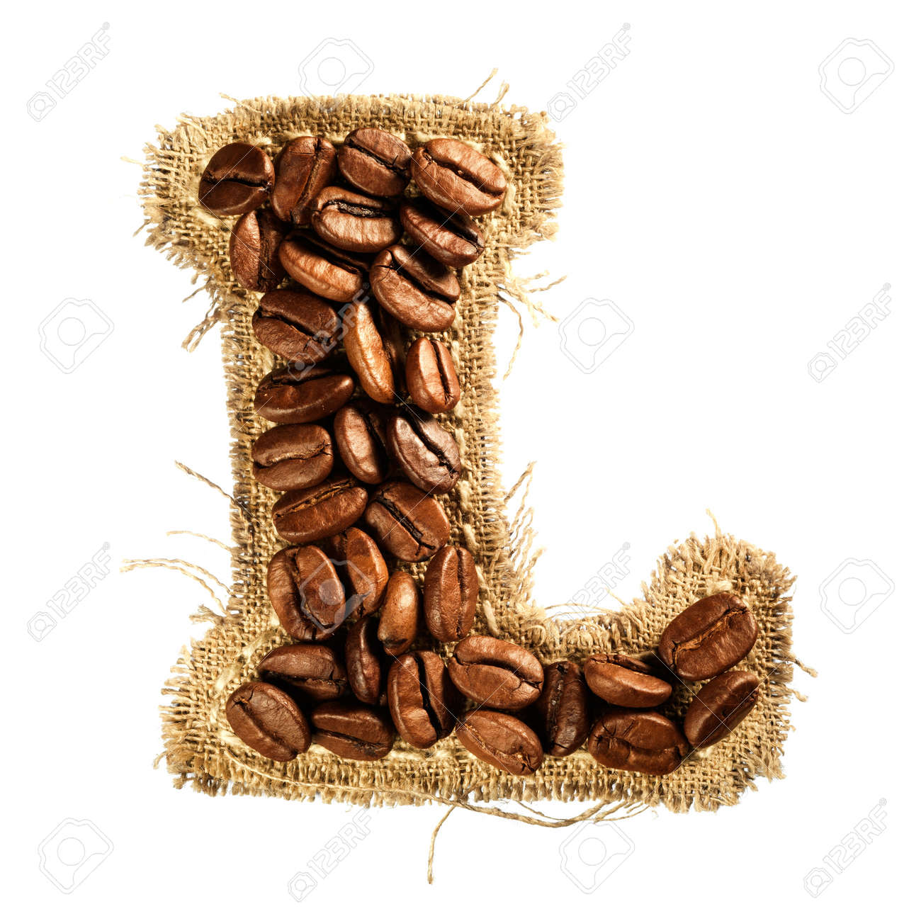 Alphabet from coffee beans on fabric texture isolated on white background Stock Photo - 17468130