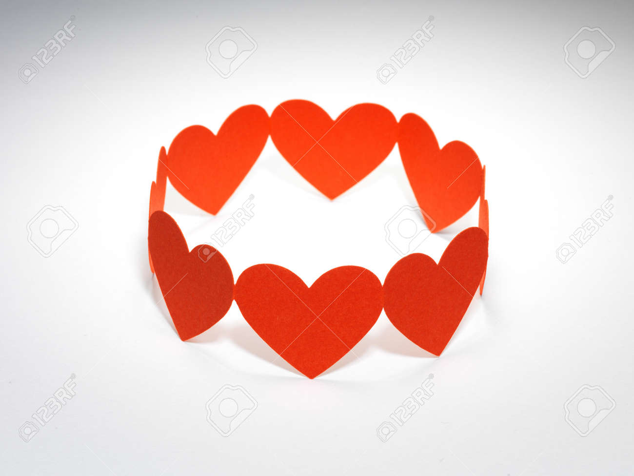 Group of red valentine hearts connected in chain, paper craft Stock Photo - 17604281