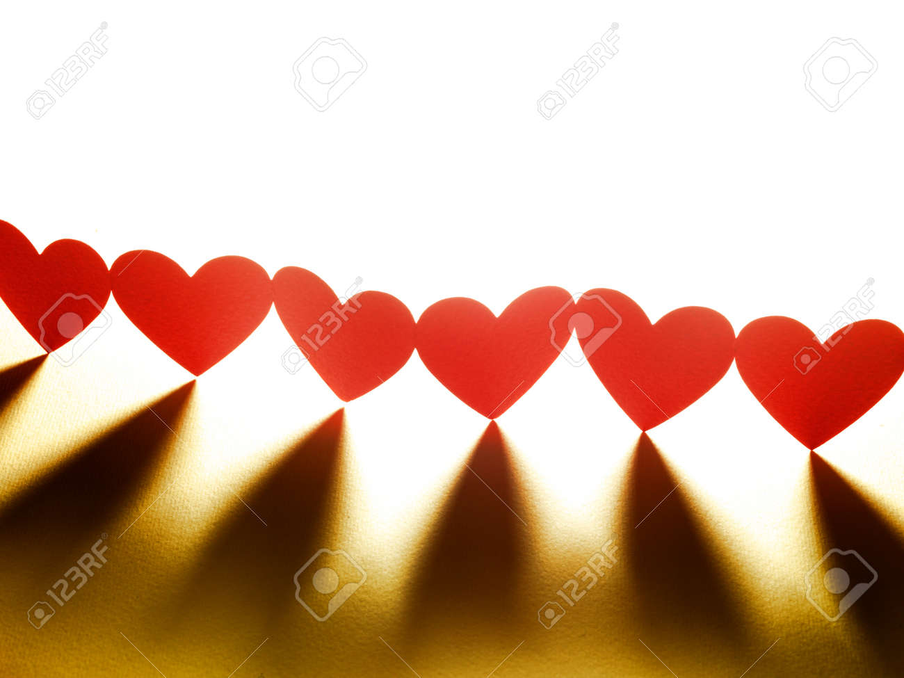 Group of red valentine hearts connected in chain, paper craft Stock Photo - 17604315
