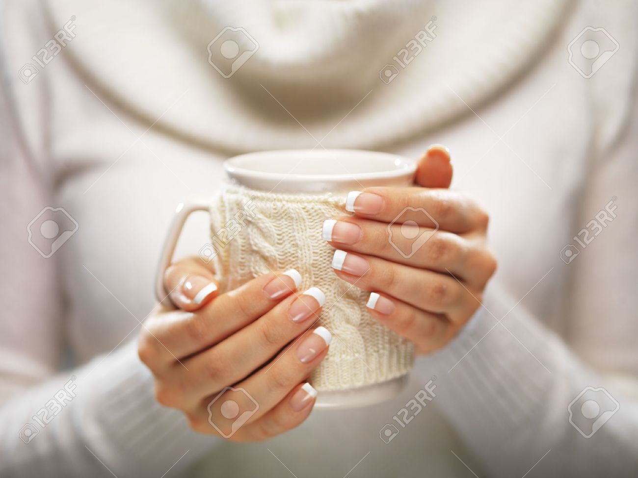 Woman Holds A Winter Cup Close Up On Light Background. Woman.. Stock ...