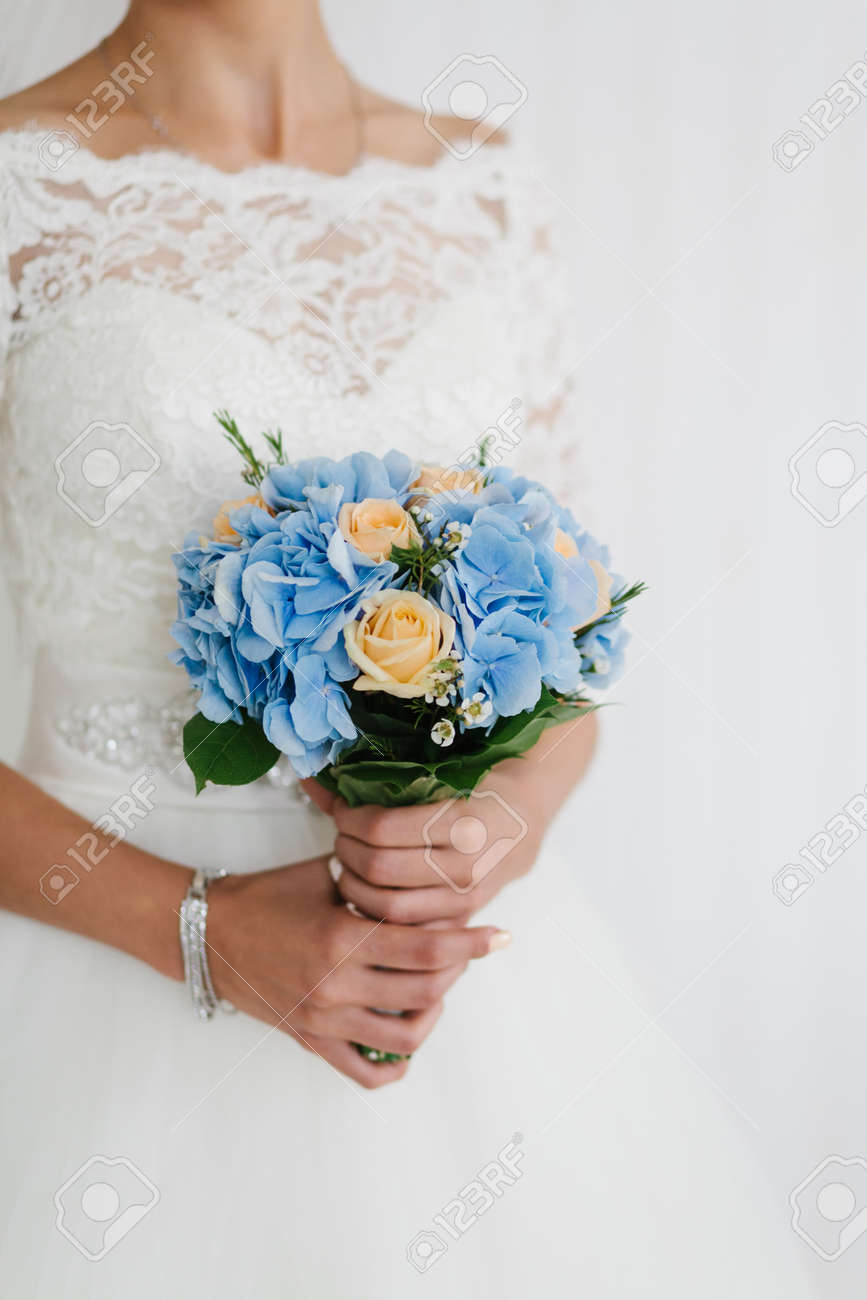 Beautiful Blue And Yellow Fresh Flowers Wedding Bouquet. Bride ...