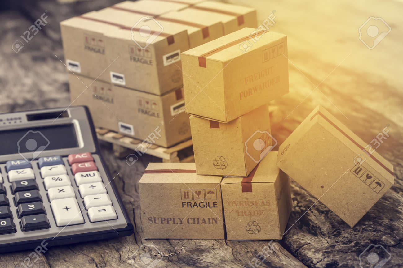 business concept: Cardboard boxes and calculator. Concept of Increasing product rates the expansion of export business to plan marketing or finance go future. - 158176161