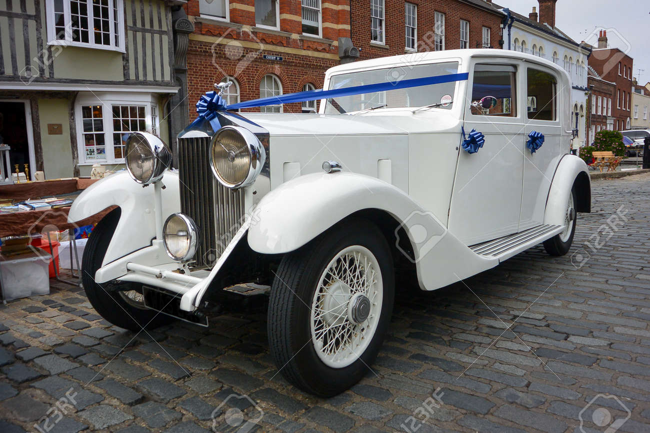 White Rolls Royce With Decorated With Blue Ribbons For A Wedding Stock Photo Picture And Royalty Free Image Image 31519239