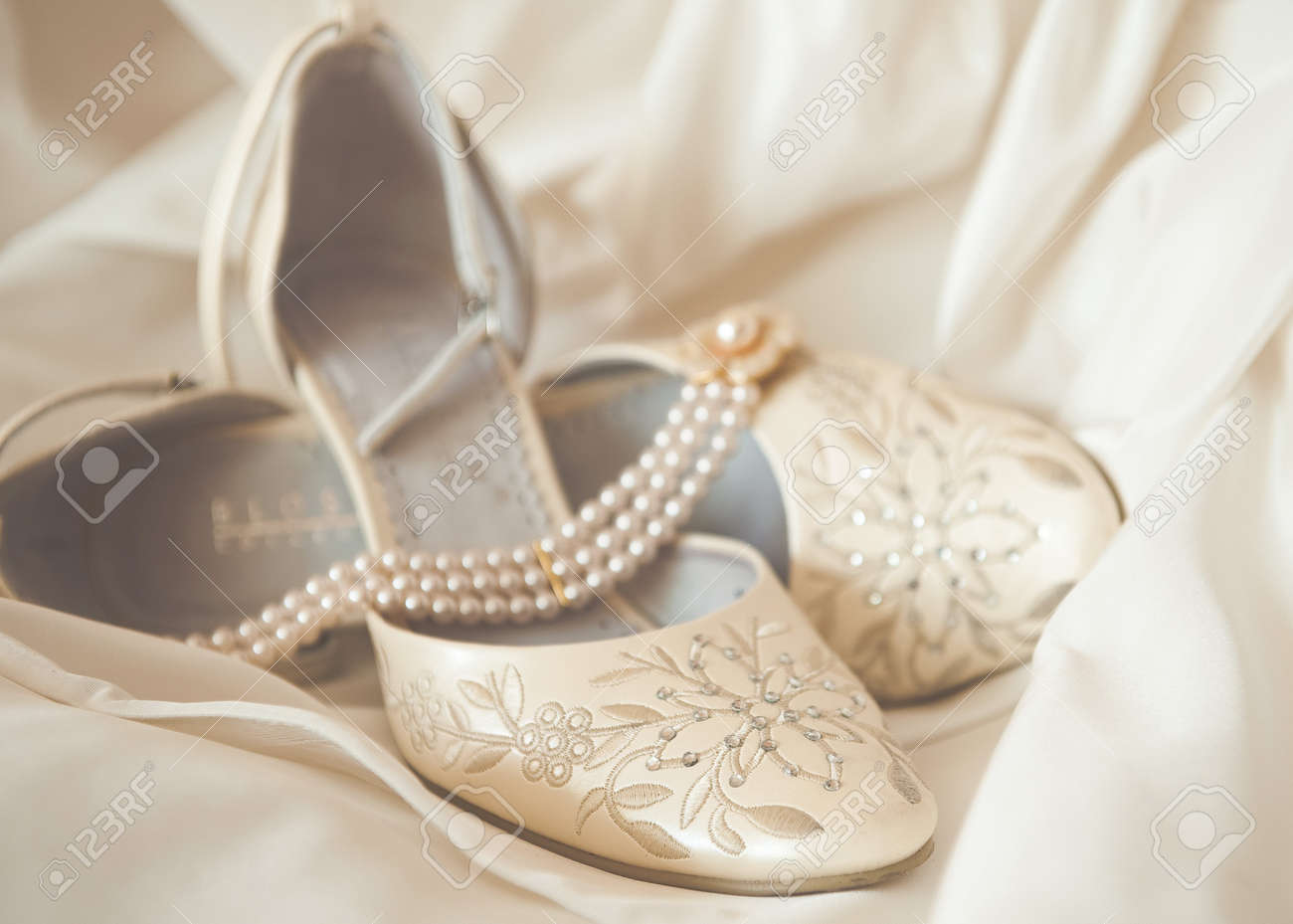 Beautiful Luxury White Wedding Shoes With Pearl Necklace Stock