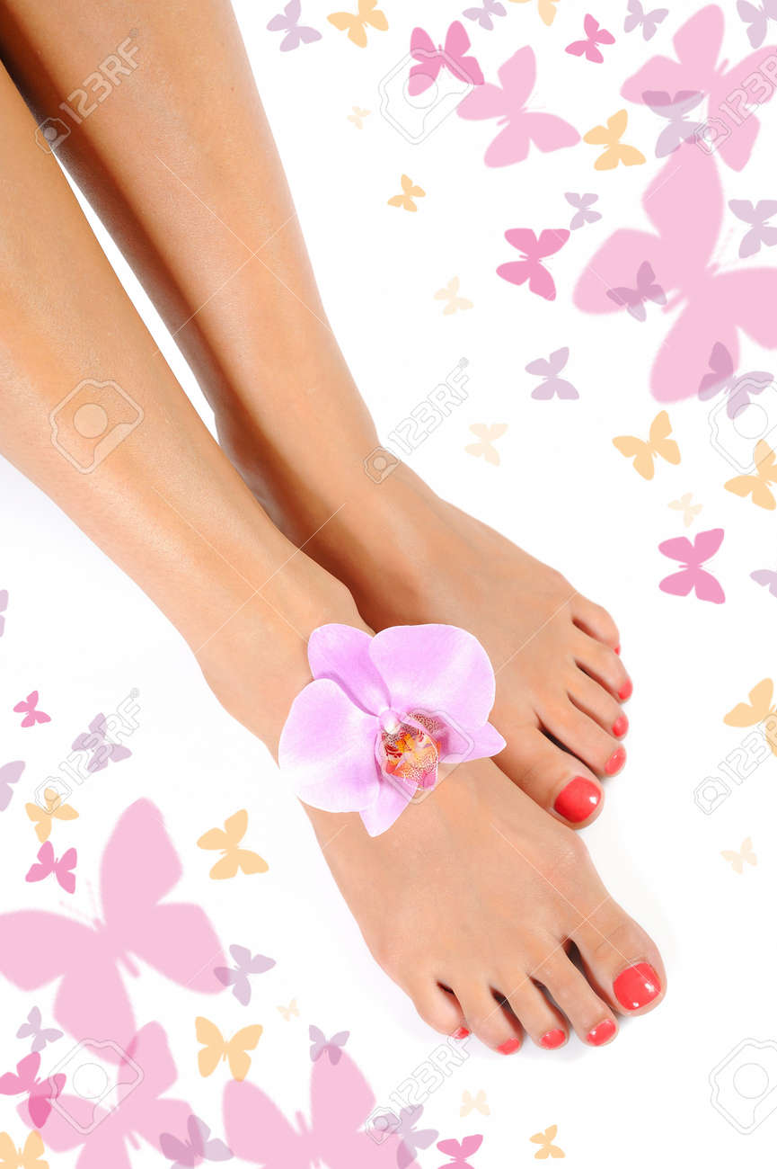 Beautiful feet leg with perfect spa pedicure on bright pink nails. white background Stock Photo - 7880445