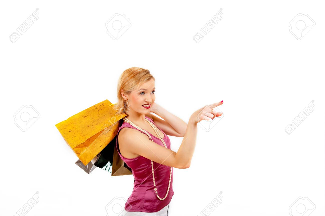 Young sexy shopping girl with lots of colourfull bags. isolated an white background Stock Photo - 7874247