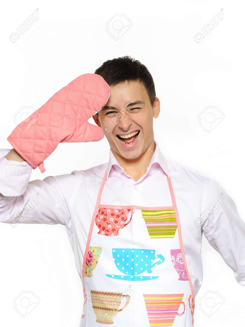 Young happy cook man in apron smiling and leathing. isolated on white background Stock Photo - 7997580