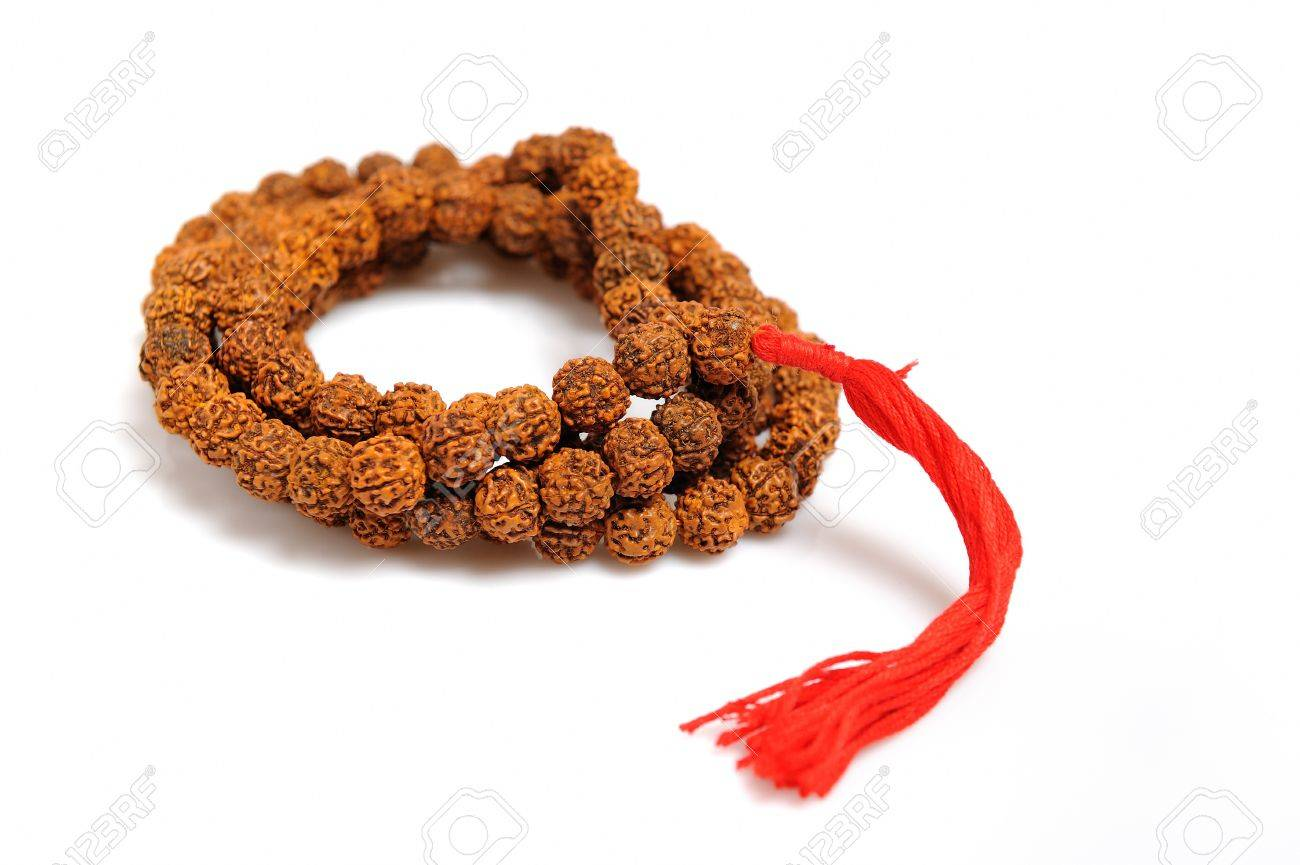 Traditional indian rosary for meditation - mala . isolated on white background Stock Photo - 8045274