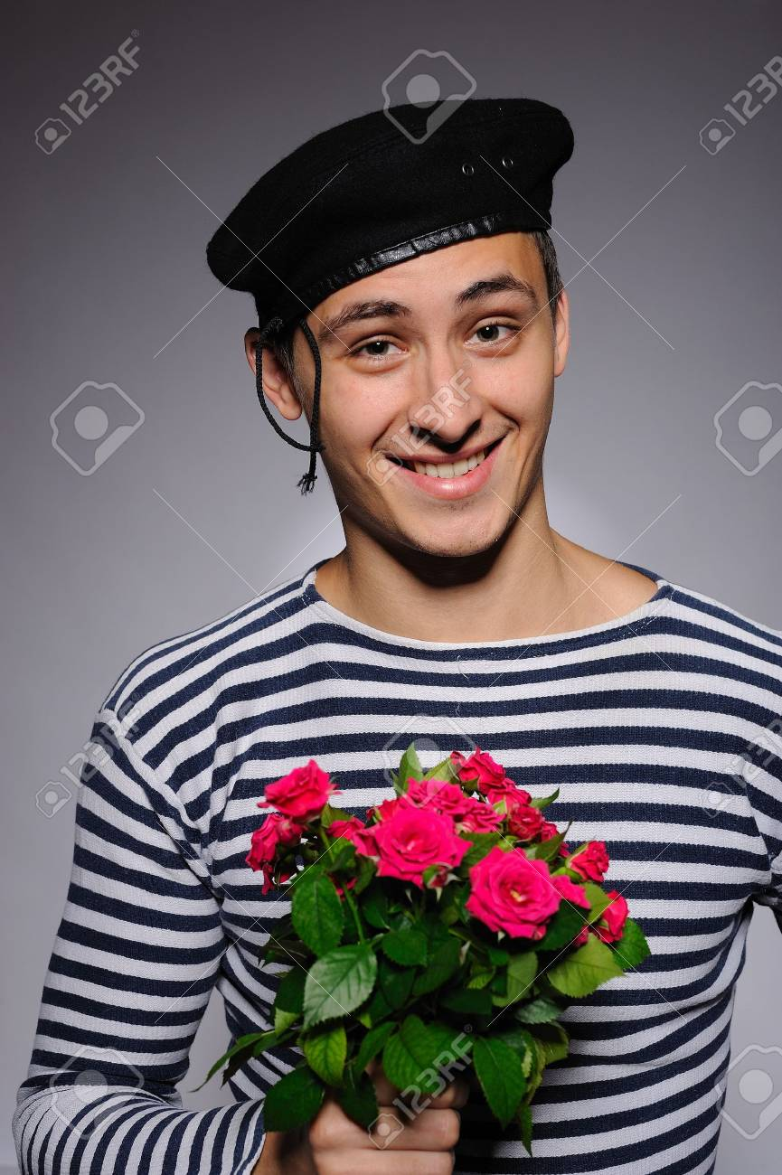 Funny emotional romantic sailor man holding rose flowers prepared for a date Stock Photo - 8088915