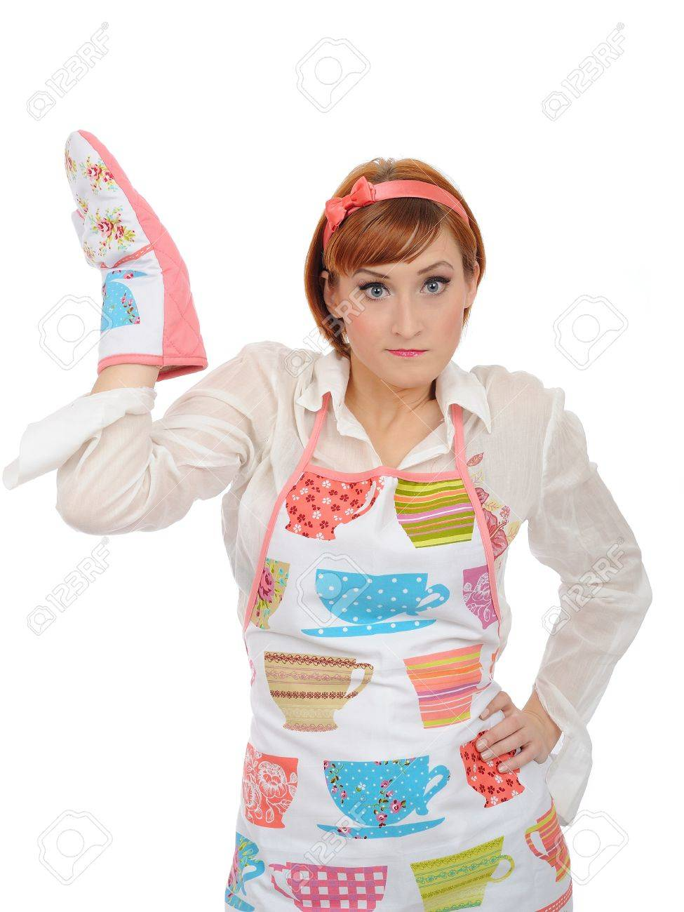expressions. Beautiful cooking woman in apron and kitchen glove having problem. isolated on white background Stock Photo - 8157876