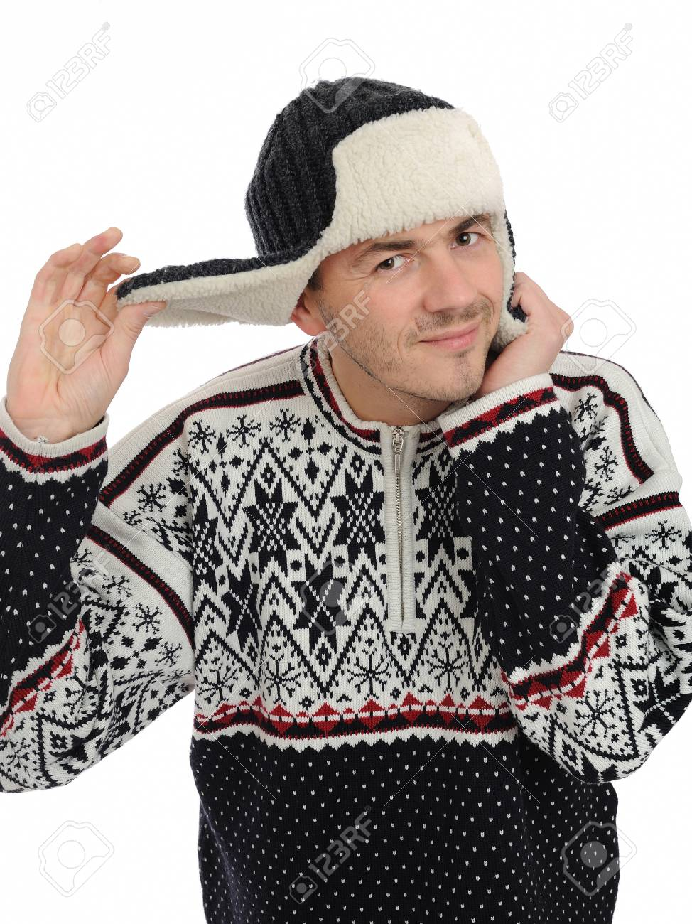 expressions. Funny winter man in warm hat and clothes listening. isolated on white background Stock Photo - 8244166