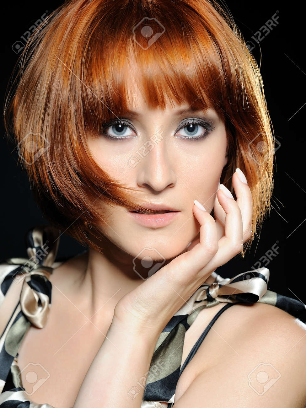 Beautiful red haired woman with fashion bob hairstyle and creative trendy make-up Stock Photo - 8328474