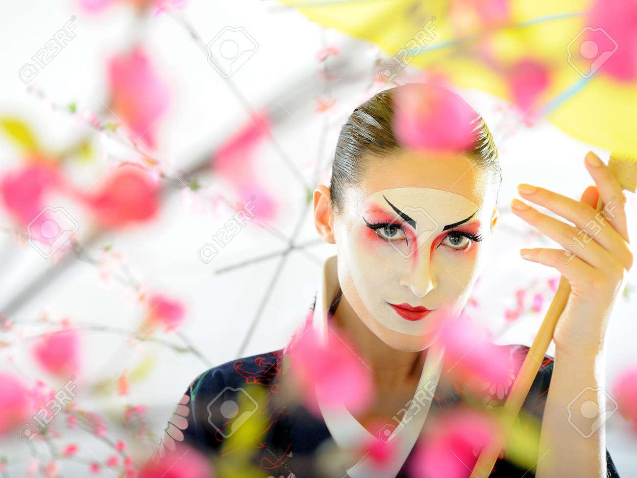 japan geisha woman with creative make-up in sakura garden.close-up artistic portrait Stock Photo - 8949814