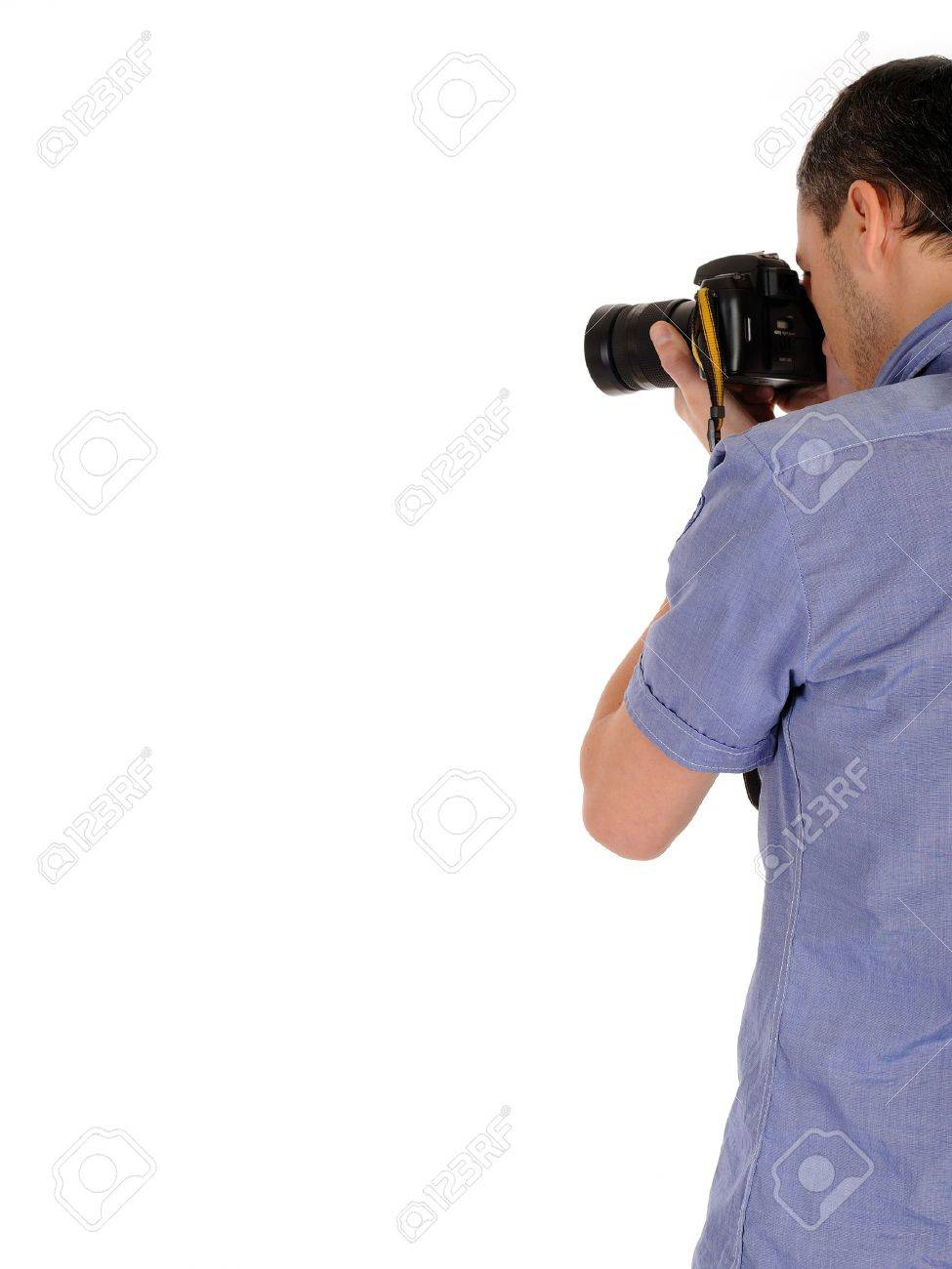professional male photographer from back taking picture.copyspace . isolated on white background - 9160597