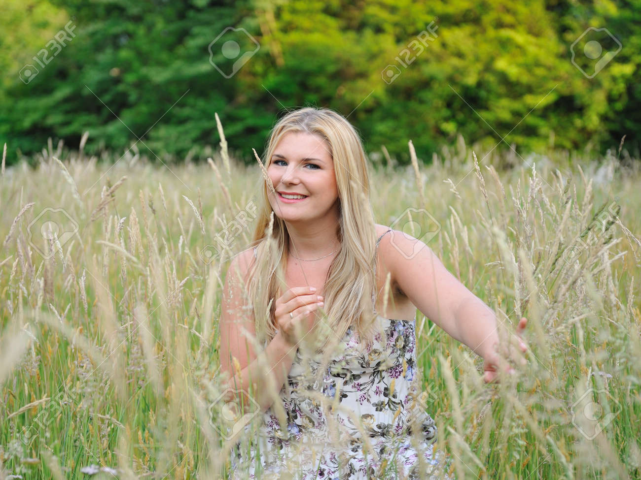 Pretty summer woman on yellow wheat field in countryside Stock Photo - 9802285