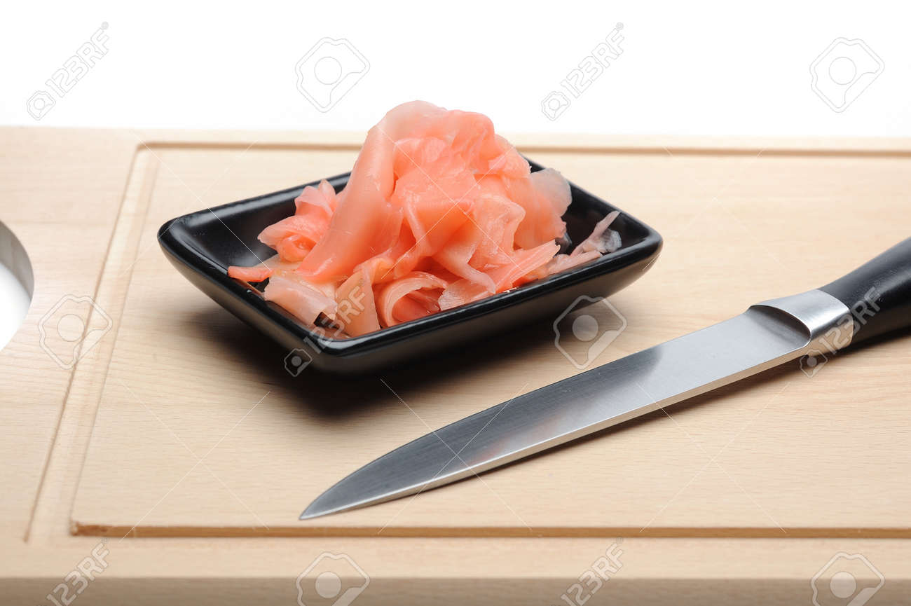 pink ginger ingredient for sushi on wooden board. isolated Stock Photo - 11257410