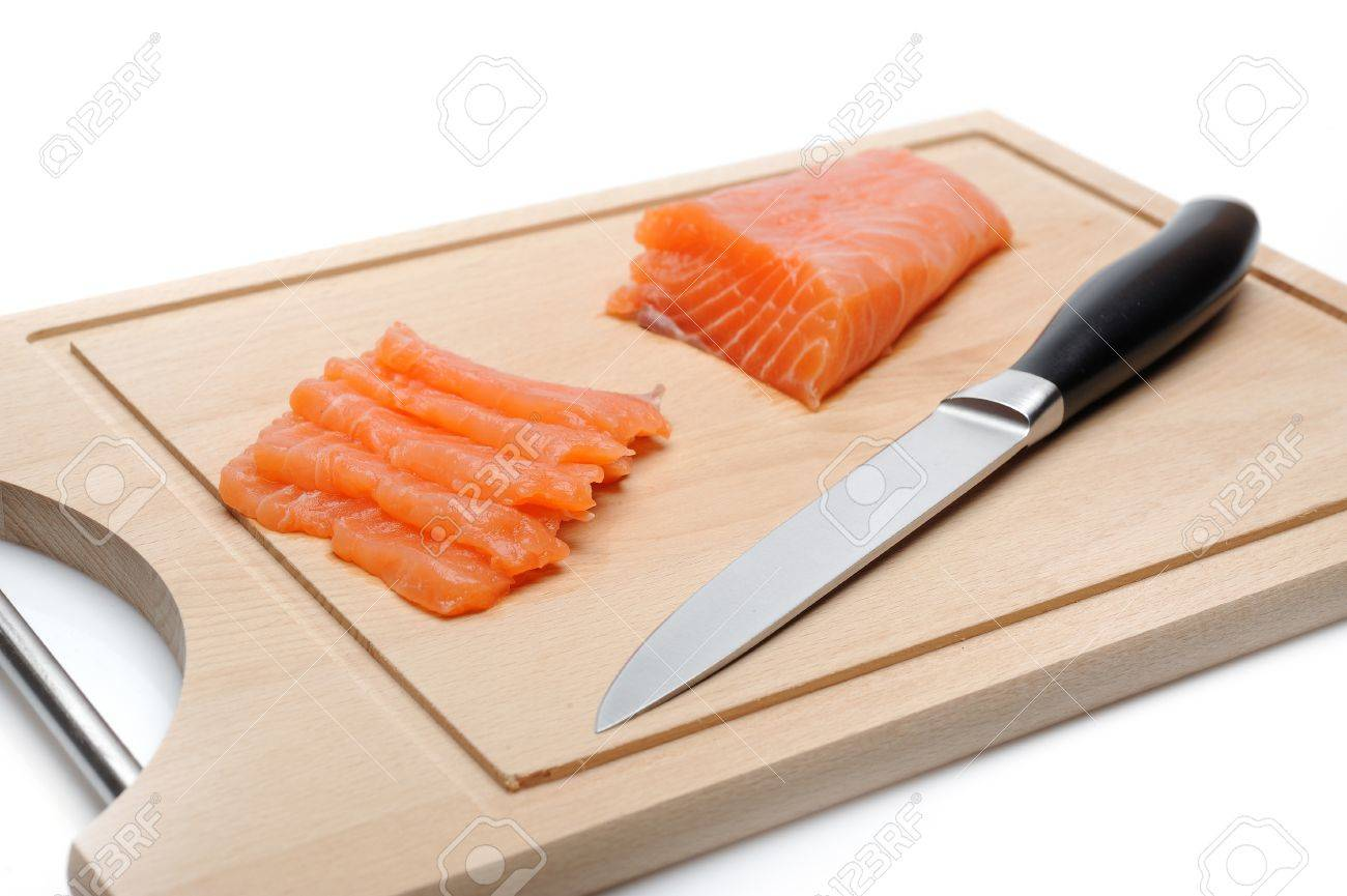 fresh raw salmon fish on wooden board isolated. sushi ingredient Stock Photo - 11257412