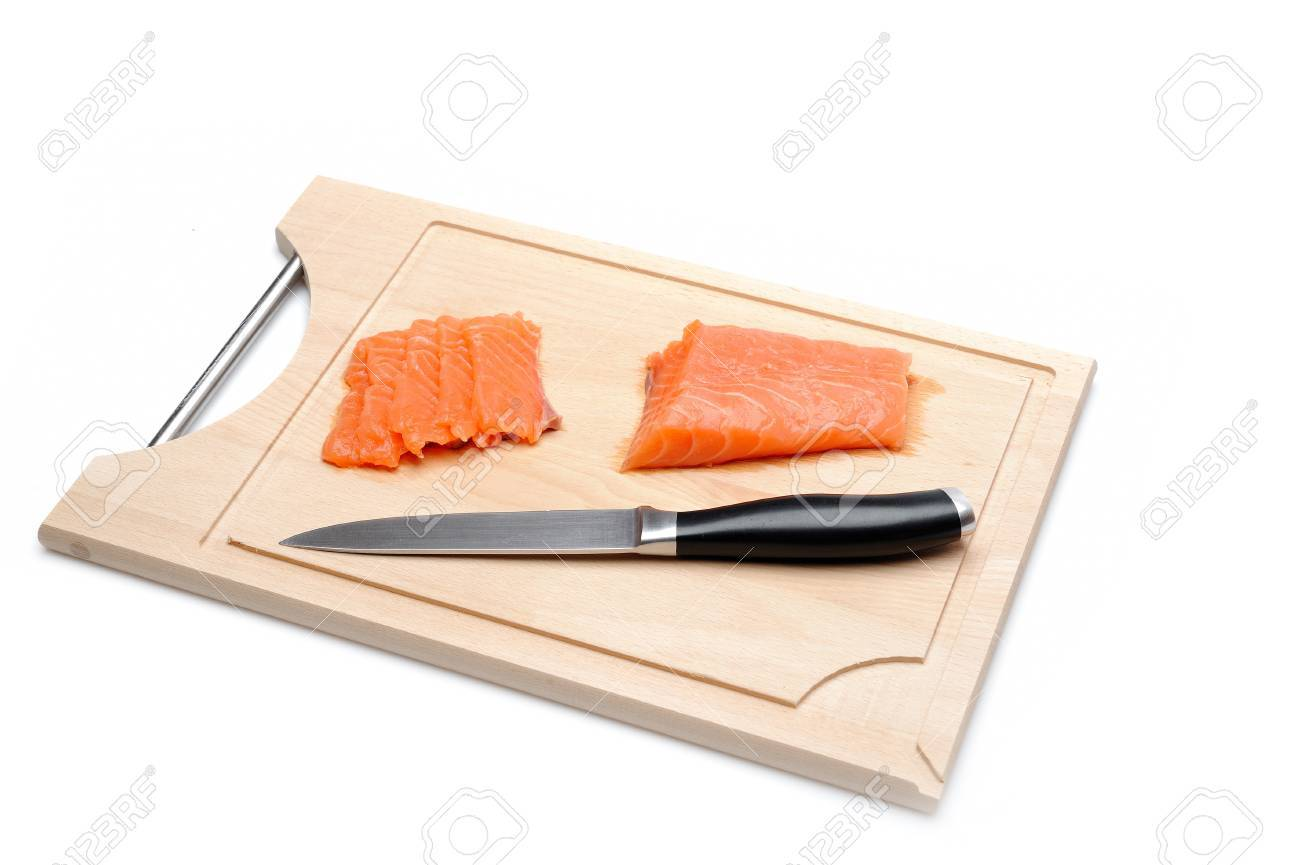 fresh raw salmon fish on wooden board isolated. sushi ingredient Stock Photo - 11423201