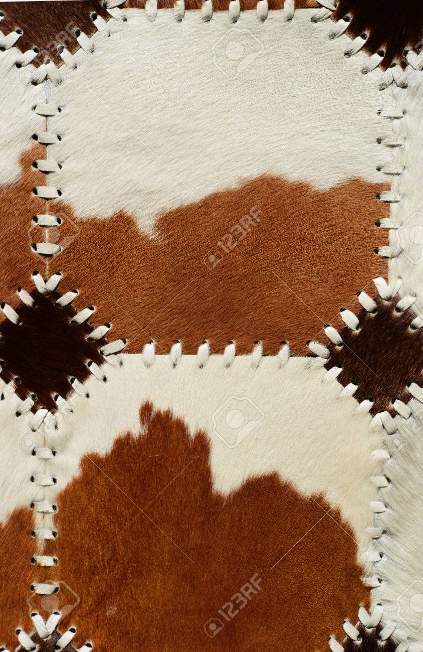 detail from cow skin rug stock photo