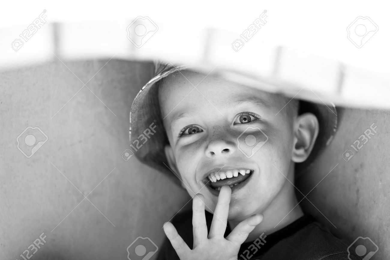 happy little boy hiding under the barbecue Stock Photo - 14205199