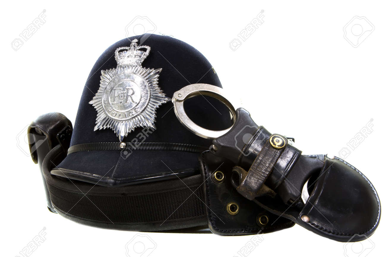 traditional british police helmet and handcuffs isolated on white Stock Photo - 15520097