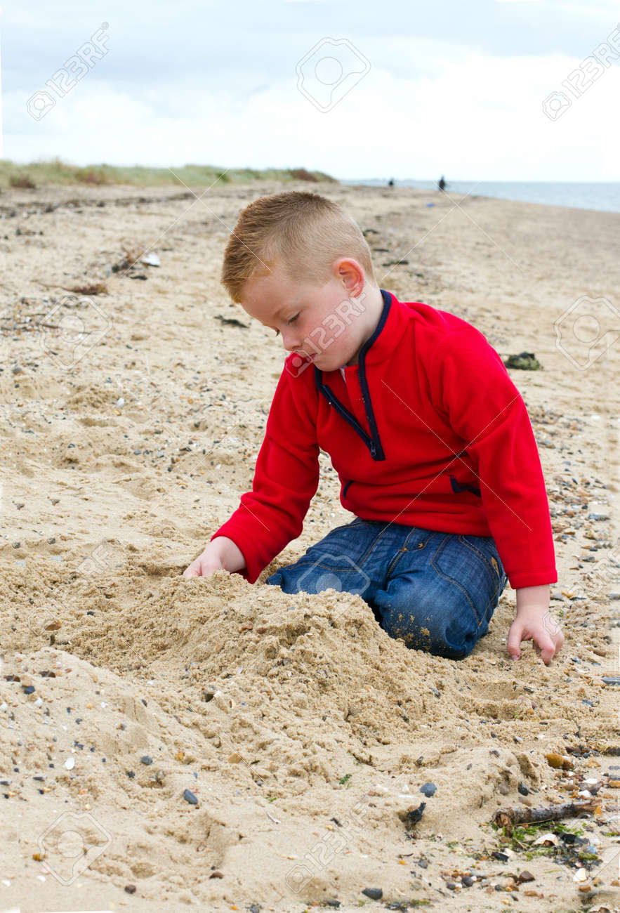 little boy playing on the beach in autumn Stock Photo - 15945798