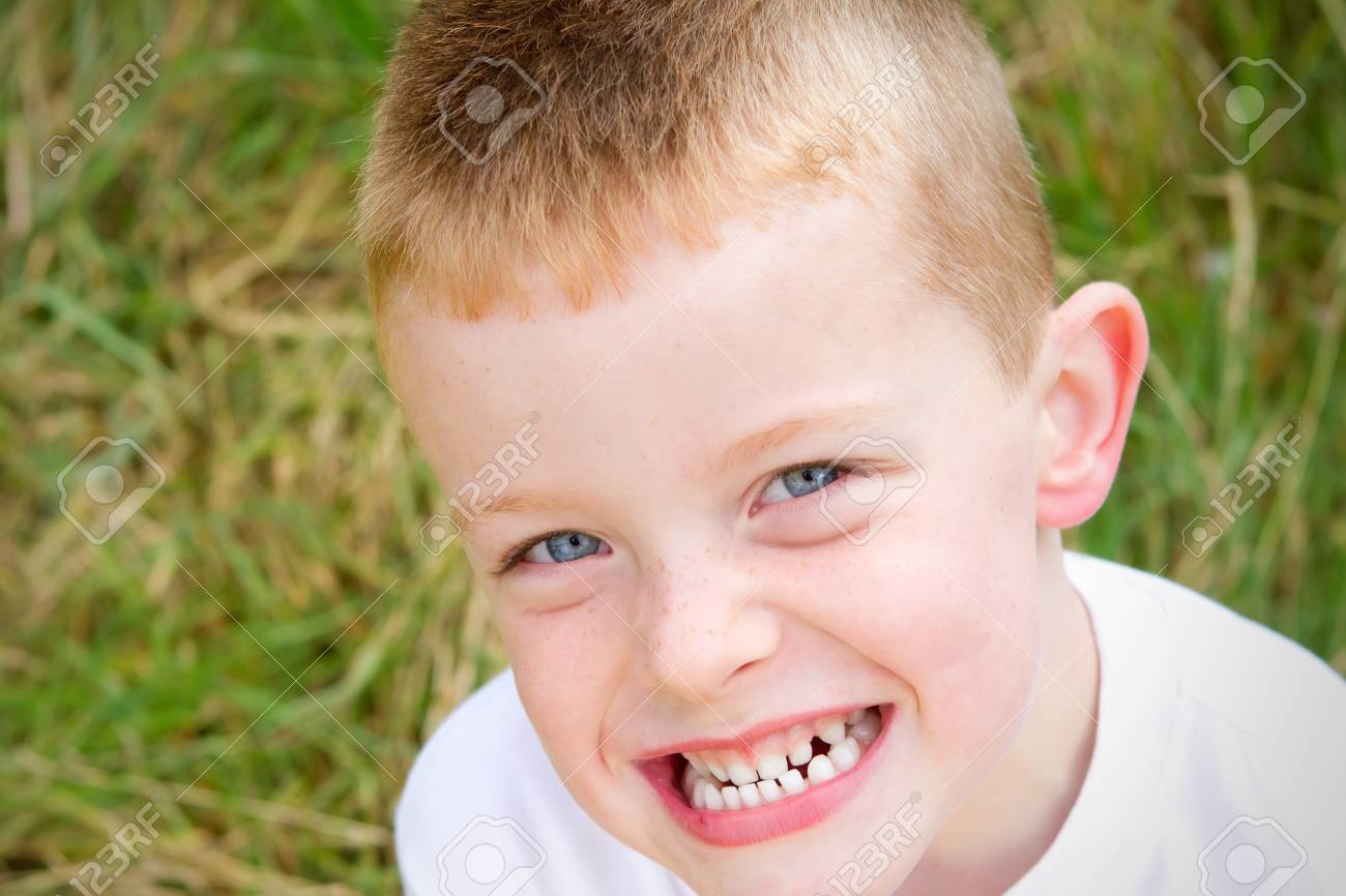 little boy smiling in the evening Autumn sun Stock Photo - 15945804