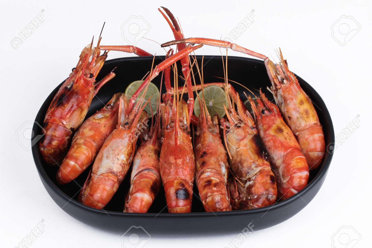 ready streamed large fresh prawns with slided lemon served on