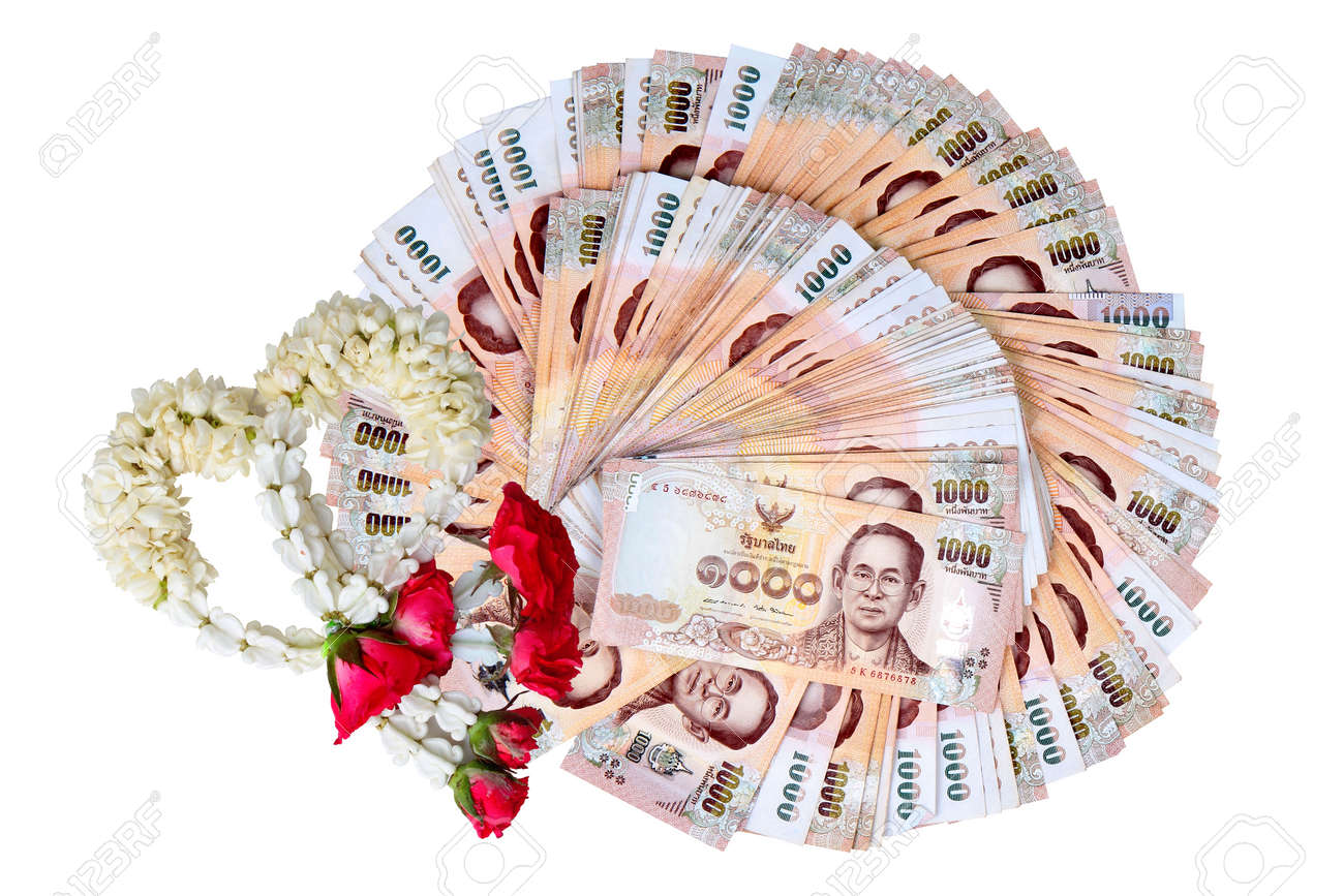 Garland,lei of flowers and curency the 1000 Baht of Thailand
