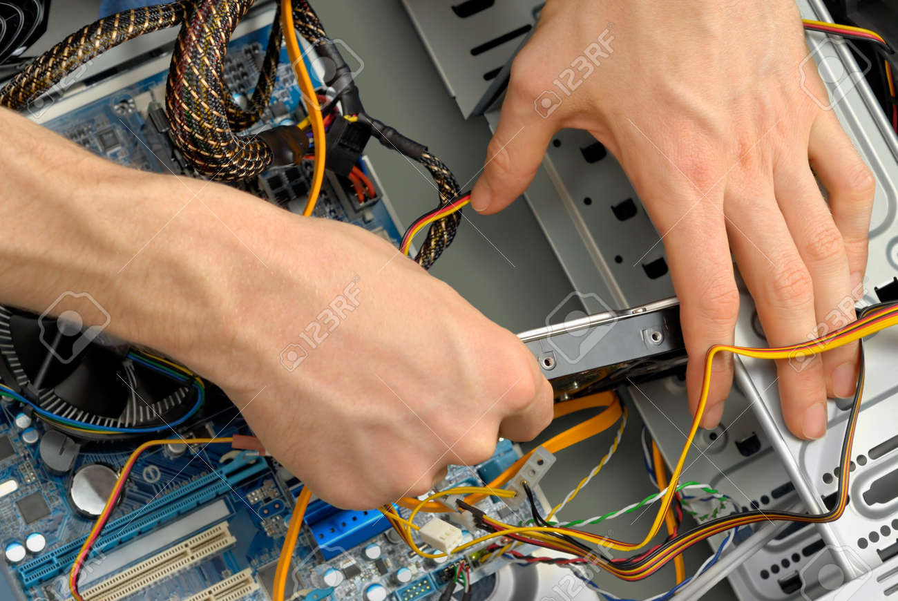 A new hard drive is being inserted into the computer case Stock Photo - 9205937