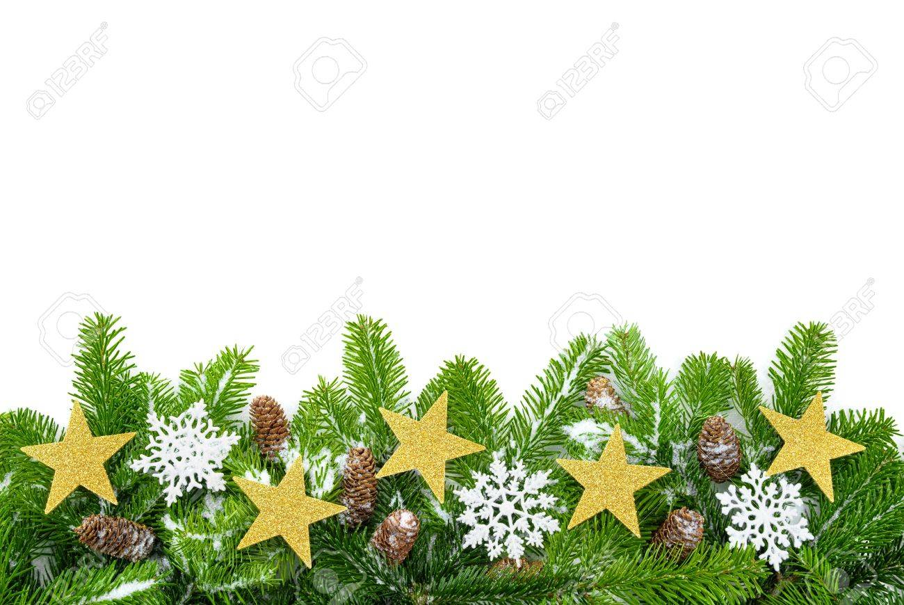 Studio shot of fresh fir twigs with stars, snow and cones on white background Stock Photo - 10676522