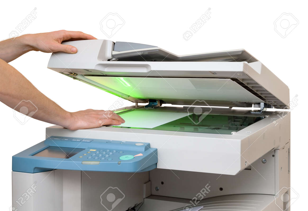 Xerox: Hands Putting A Sheet Of Paper Into A Copying Device, Isolated On  White