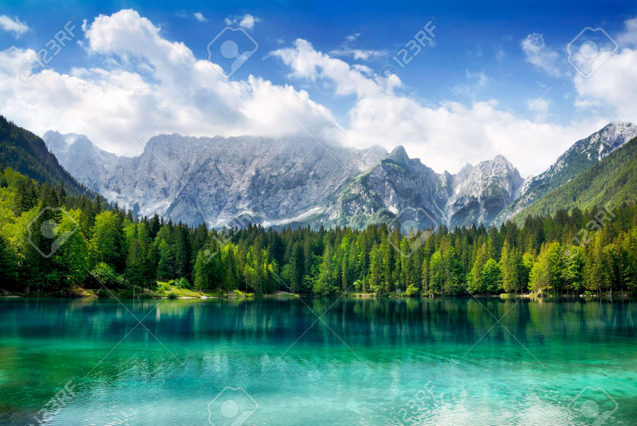 Beautiful landscape with turquoise lake, forest and mountains - 17897582