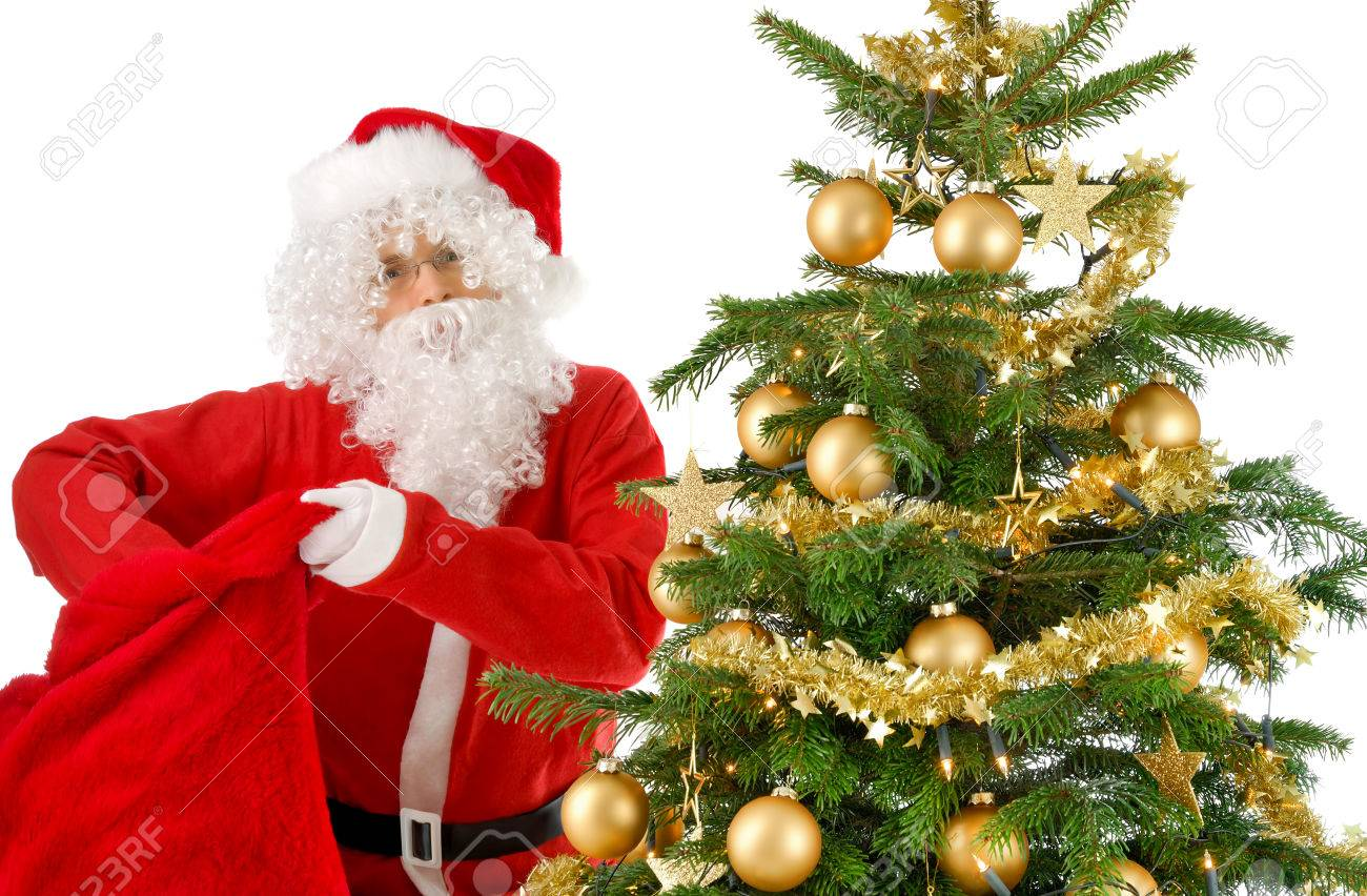 Camera christmas ornaments - Santa Claus Beside A Christmas Tree With Gold Ornaments Looking Into The Camera And Reaching