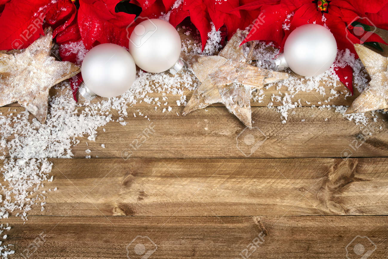 Christmas Arrangement With Poinsettia, Wooden Stars, White Baubles ...