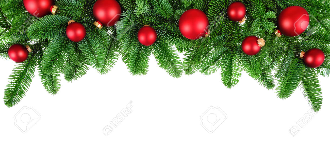 Studio isolated lush fir twigs with red baubles as a bow-shaped border on pure white background - 33670483