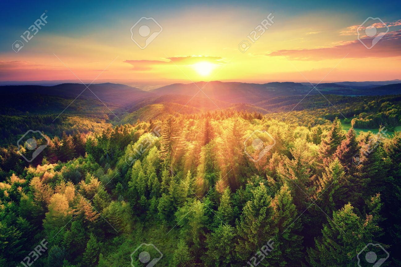 Bird's-eye view of a scenic sunset over the   forest hills, with toned dramatic colors Stock Photo - 39705042