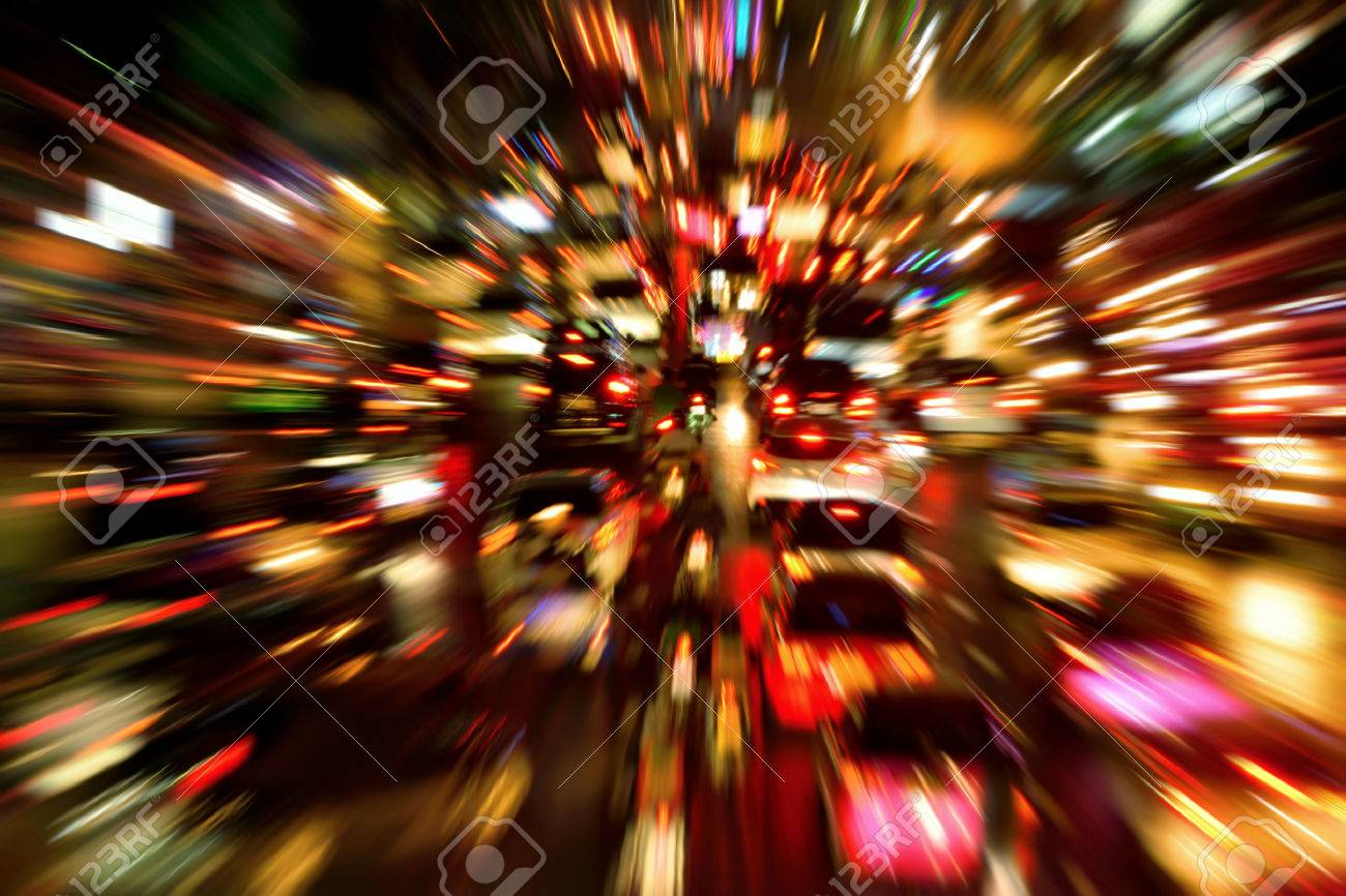 Traffic jam on a large street in the city, night shot with dynamic blur effect - 44219565