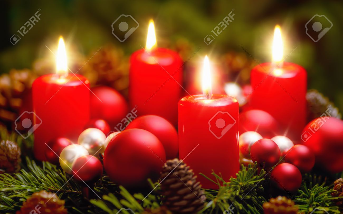 Studio shot of a nice advent wreath with baubles and four burning red candles - 46937748