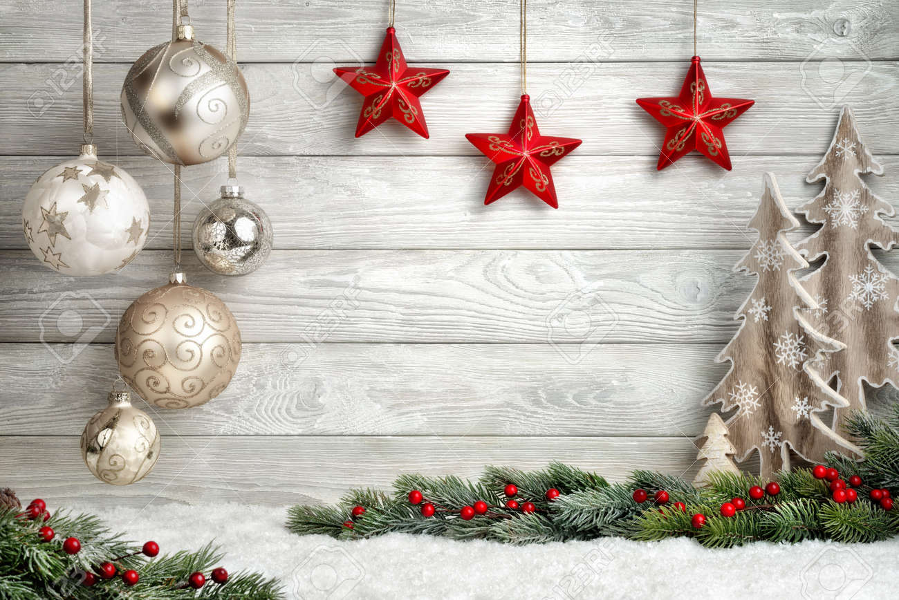 Christmas background in bright wood style, modern, simple and elegant, with a border of baubles, fir branches, stars, ornamental trees and snow - 49187787